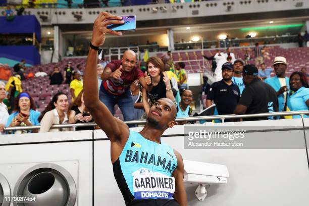 Steven Gardiner of the Bahamas celebrates winning gold as he take a selfie photograph with spectators after the Men's 400 metres final during day...
