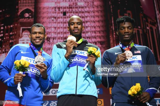 Steven Gardiner of the Bahamas, gold, Anthony José Zambrano of Colombia, silver, and Fred Kerley of the United States, bronze, pose during the medal...
