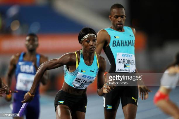Steven Gardiner passes the baton to Shaunae MillerUibo of the Bahamas during the Mixed 4x400 Metres Relay Final during the IAAF/BTC World Relays...