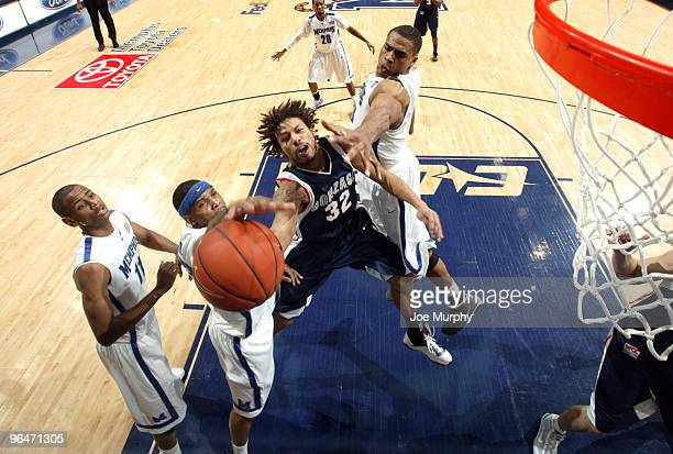 Steven Gay of the Gonzaga Bulldogs drives to the basket between Roburt Sallie and Will Coleman of the Memphis Tigers on February 6, 2010 at...