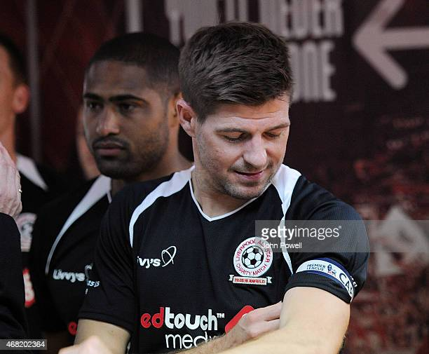 Steven Gerrard adjusting his captain's armband before the Liverpool All Star Charity Match at Anfield on March 29 2015 in Liverpool England