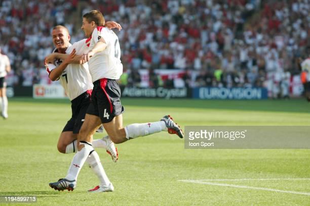 Steven GERRARD and David BECKHAM of England celebrates during the European Championship match between England and Switzerland at Estadio Cidade de...