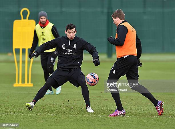 Steven Gerrard and Dejan Lovren of Liverpool during a training session at Melwood Training Ground on February 2 2015 in Liverpool England