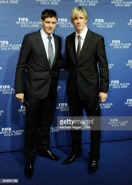 Steven Gerrard and Fernando Torres pose for photographers as they arrive for the FIFA World Player Gala on December 21 2009 in Zurich Switzerland