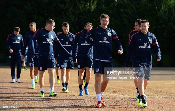 Steven Gerrard and James Milner lead the team out during the England training session at London Colney on October 10, 2013 in St Albans, England.