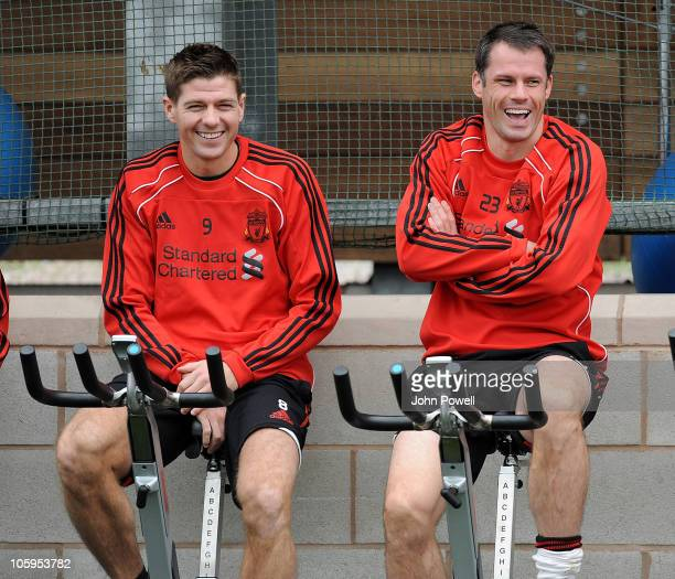 Steven Gerrard and Jamie Carragher of Liverpool attend a Liverpool FC training session at Melwood training Ground on October 22 2010 in Liverpool...