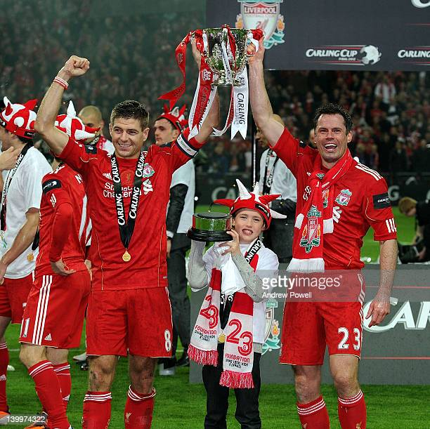 Steven Gerrard and Jamie Carragher of Liverpool hold the trophy aloft and celebrate at the end of the Carling Cup Final match between Liverpool and...