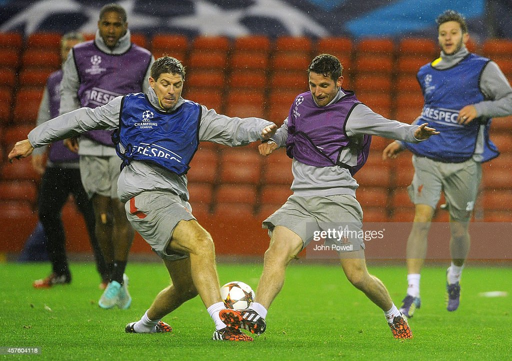Steven Gerrard and Joe Allen of Liverpool in action during a training session at Anfield on October 21, 2014 in Liverpool, United Kingdom.
