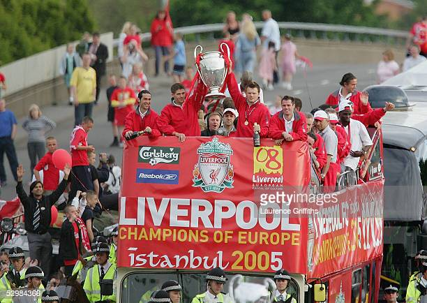 Steven Gerrard and John Arne Riise hold the trophy aloft during the homecoming victory parade through the streets of Liverpool on May 26 2005 in...