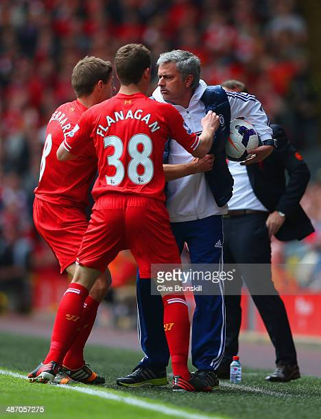Steven Gerrard and Jon Flanagan of Liverpool have words with Jose Mourinho manager of Chelsea during the Barclays Premier League match between...