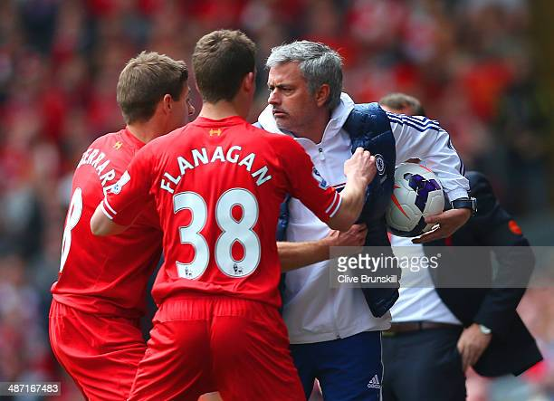 Steven Gerrard and Jon Flanagan of Liverpool have words with Jose Mourinho manager of Chelsea as he holds onto the ball during the Barclays Premier...