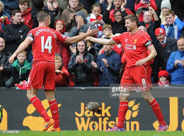 Steven Gerrard and Jordan Henderson of Liverpool celebrate the winning goal during the Barclays Premier League match between Liverpool and Queens...