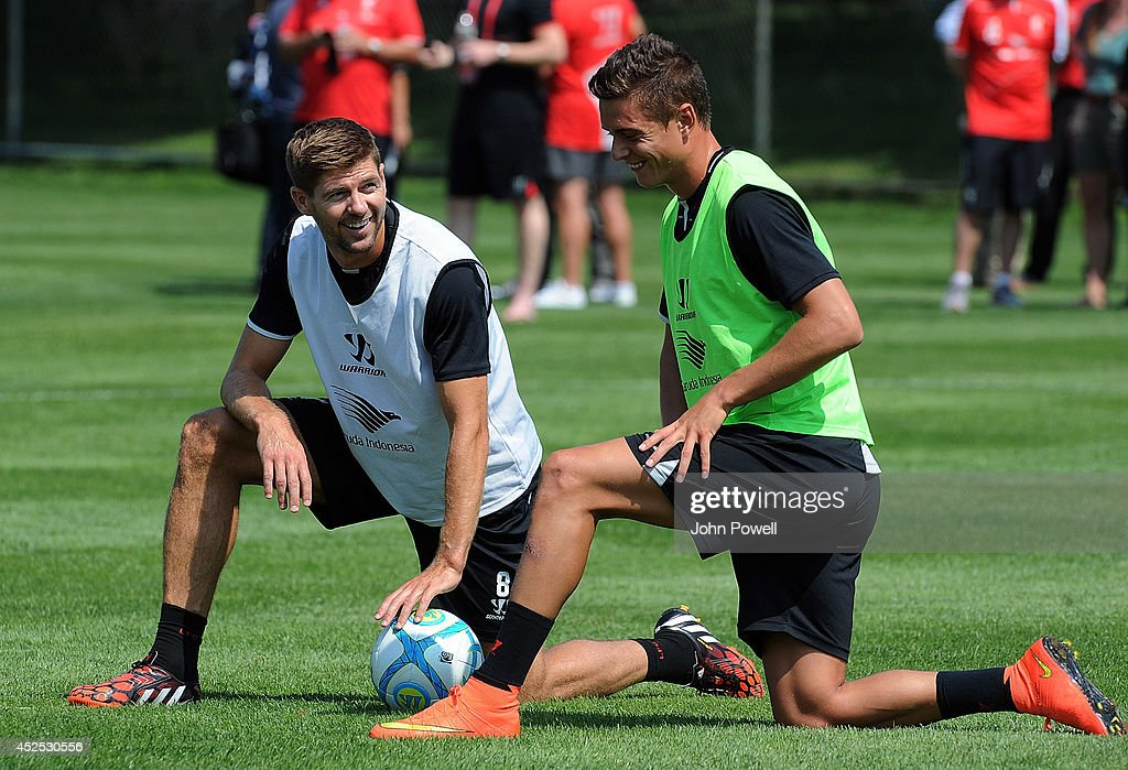 Steven Gerrard and Kristoffer Peterson of Liverpool laugh during a training session at Harvard University on July 22, 2014 in Cambridge, Massachusetts.