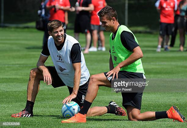 Steven Gerrard and Kristoffer Peterson of Liverpool laugh during a training session at Harvard University on July 22 2014 in Cambridge Massachusetts