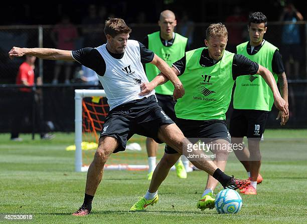 Steven Gerrard and Lucas Leiva of Liverpool in action during a training session at Harvard University on July 22 2014 in Cambridge Massachusetts