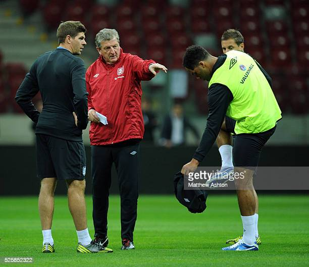 Steven Gerrard and Roy Hodgson the England head coach / manager during the training session with Joleon Lescott taking his shorts off