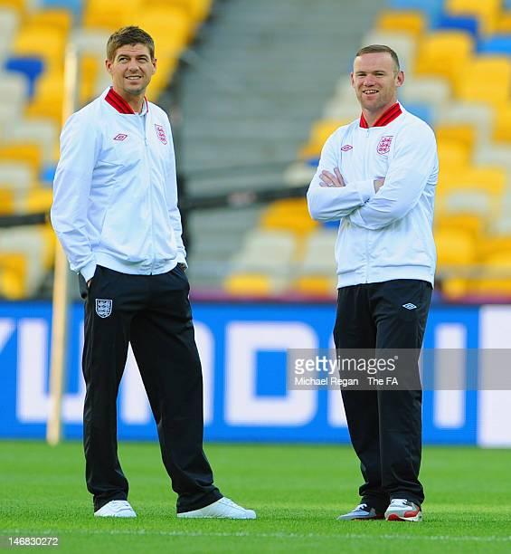Steven Gerrard and Wayne Rooney walk around the pitch at the Olympic Stadium on June 23, 2012 in Kiev, Ukraine.