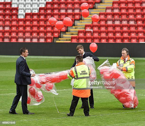 Steven Gerrard capitan of Liverpool and Phil Jagielka capitan of Everton letting 96 bloons fly away during the memorial service marking the 26th...