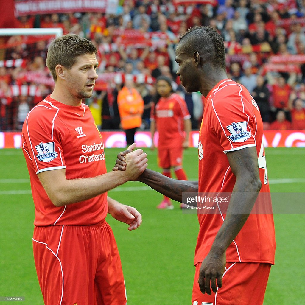 Steven Gerrard captain of Liverpool shakes hands with Mario Balotelli of Liverpool before the kick off of the Barclays Premier League match between Liverpool and Aston Villa at Anfield on September 13, 2014 in Liverpool, England.