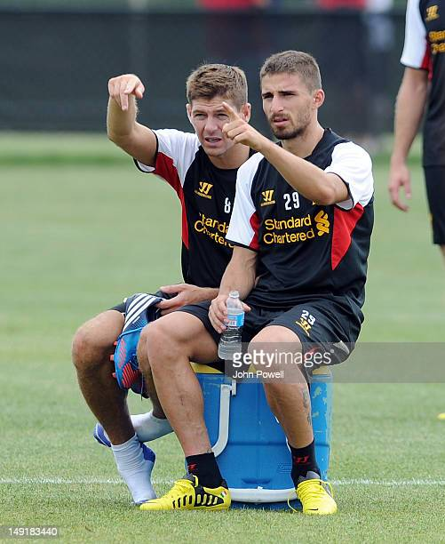 Steven Gerrard captain of Liverpool talks with their new signing Fabio Borini during a training session at Harvard University on July 24 2012 in...