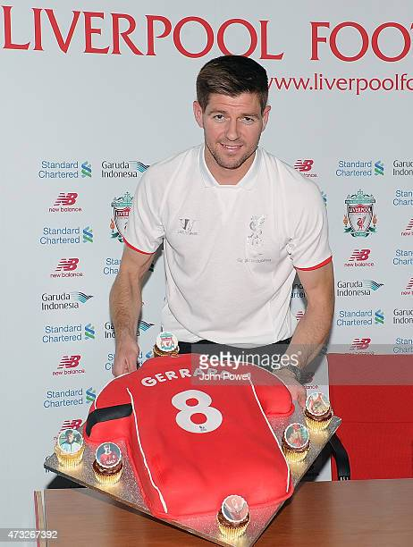 Steven Gerrard captain of Liverpool with a cake presented to him during a Press Conference at Melwood Training Ground on May 14 2015 in Liverpool...