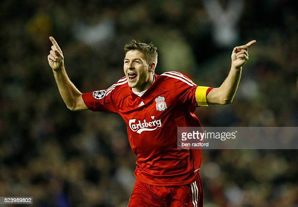 Steven Gerrard celebrates scoring his 100th goal for the Liverpool during the UEFA Champions League Group D match between Liverpool and PSV Eindhoven...