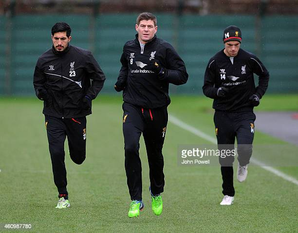 Steven Gerrard Emre Can and Jordan Henderson of Liverpool warm up during a training session at Melwood Training Ground on January 3 2015 in Liverpool...