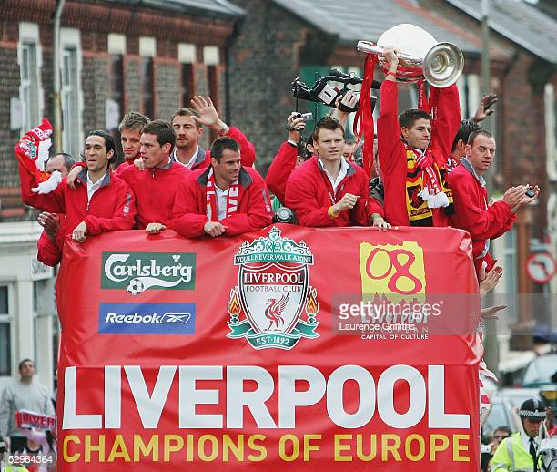 Steven Gerrard holds the trophy aloft during the homecoming victory parade through the streets of Liverpool on May 26 2005 in Liverpool England...