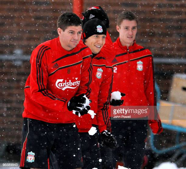 Steven Gerrard, Lucas Leiva and Stephen Darby play in the snow during a training session at Melwood Training Ground on January 5, 2010 in Liverpool,...