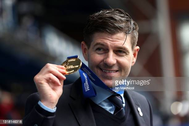 Steven Gerrard, Manager of Rangers celebrates with the Scottish Premiership winners medal following the Scottish Premiership match between Rangers...