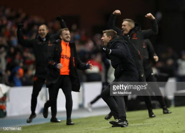 Steven Gerrard Manager of Rangers FC celebrates his sides third goal during the UEFA Europa League round of 32 first leg match between Rangers FC and...