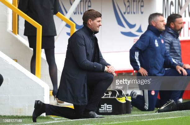 Steven Gerrard Manager of Rangers FC takes a knee in support of the Black Lives Matter movement prior to the Ladbrokes Premiership match between...