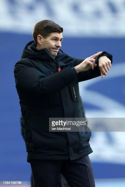 Steven Gerrard, Manager of Rangers gestures towards his watch during the Ladbrokes Scottish Premiership match between Rangers and Celtic at Ibrox...