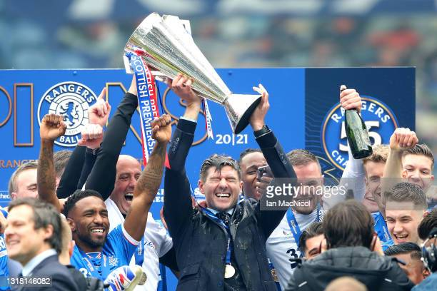 Steven Gerrard, Manager of Rangers lifts the Scottish Premiership Trophy in celebration with his players following the Scottish Premiership match...
