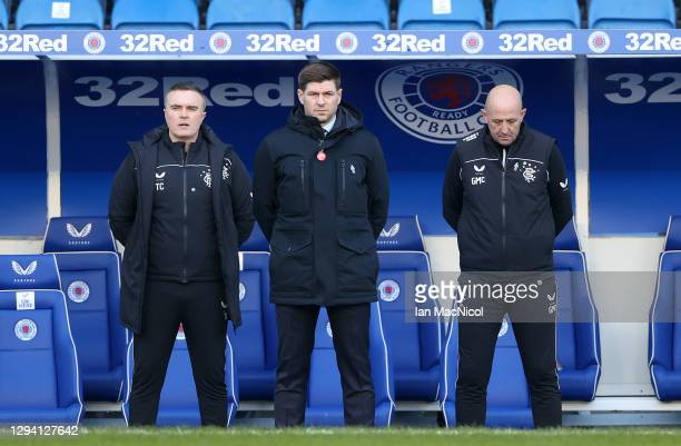 Steven Gerrard, Manager of Rangers, Michael Beale, Assistant Manager of Rangers and Gary McAllister, First Team Coach of Rangers stand for a minutes...