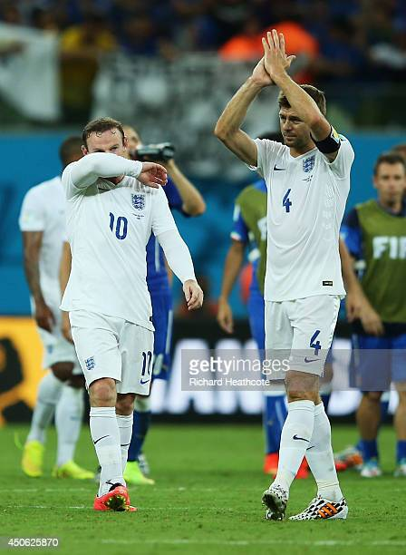 Steven Gerrard of England acknowledges the fans as Wayne Rooney looks on after being defeated by Italy 21 during the 2014 FIFA World Cup Brazil Group...