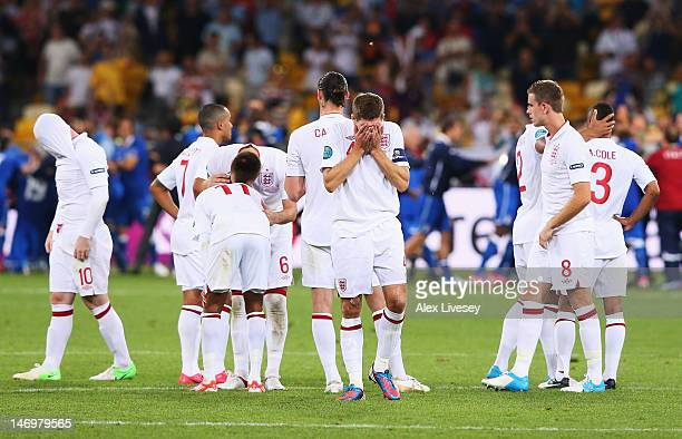 Steven Gerrard of England and teammates look dejected after the penalty shoot out during the UEFA EURO 2012 quarter final match between England and...