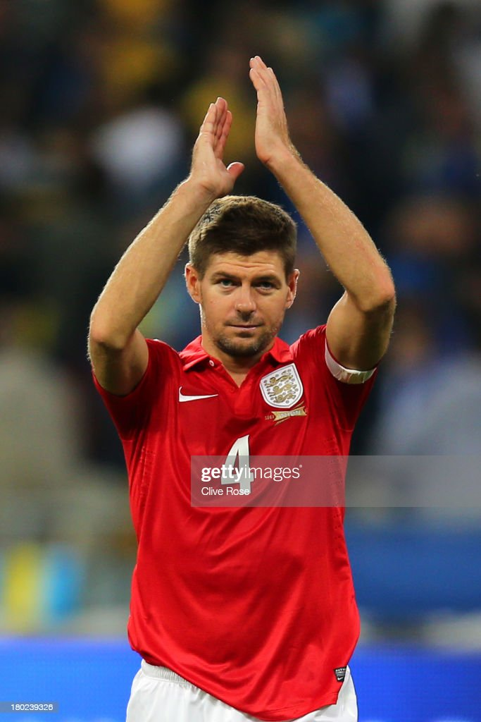 Steven Gerrard of England applauds the travelling fans following the 0-0 draw during the FIFA 2014 World Cup Qualifying Group H match between Ukraine and England at the Olympic Stadium on September 10, 2013 in Kiev, Ukraine.