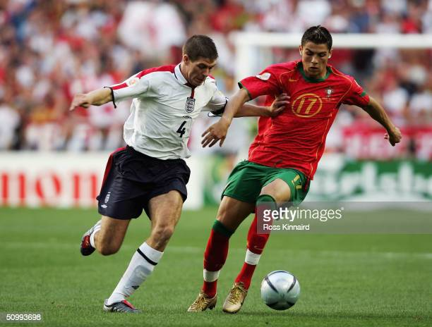 Steven Gerrard of England battles with Cristiano Ronaldo of Portugal during the UEFA Euro 2004 Quarter Final match between Portugal and England at...