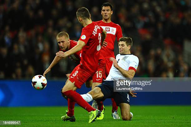 Steven Gerrard of England beats the Poland defence to score their second goal during the FIFA 2014 World Cup Qualifying Group H match between England...