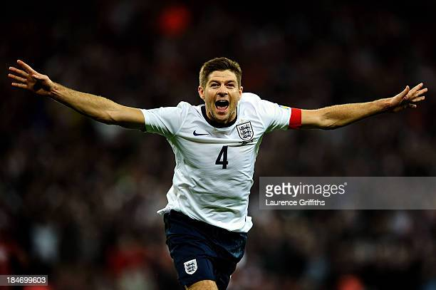 Steven Gerrard of England celebrates as he scores their second goal during the FIFA 2014 World Cup Qualifying Group H match between England and...