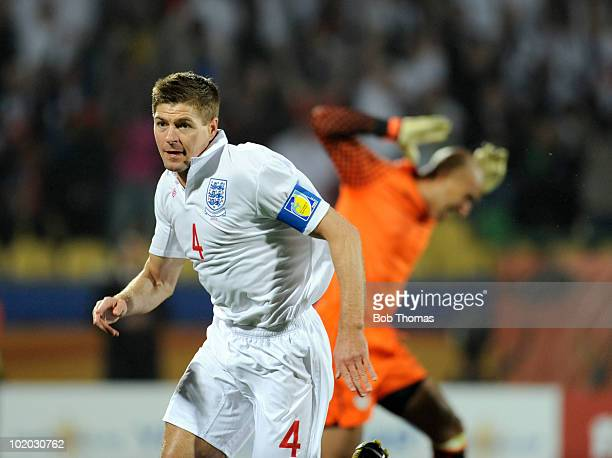 Steven Gerrard of England celebrates his goal as USA goalkeeper Tim Howard reacts during the 2010 FIFA World Cup South Africa Group C match between...