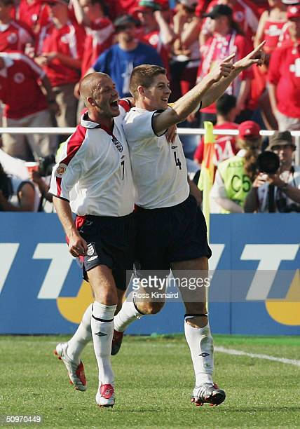 Steven Gerrard of England celebrates with David Beckham after he scores their third goal during the UEFA Euro 2004 Group B match between England and...