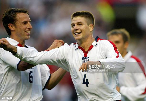 Steven Gerrard of England celebrates with Gareth Southgate after scoring the opening goal against Serbia and Montgenegro during the international...
