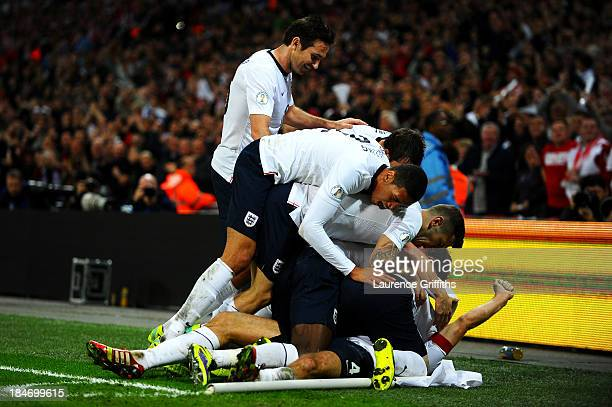 Steven Gerrard of England celebrates with team mates as he scores their second goal during the FIFA 2014 World Cup Qualifying Group H match between...