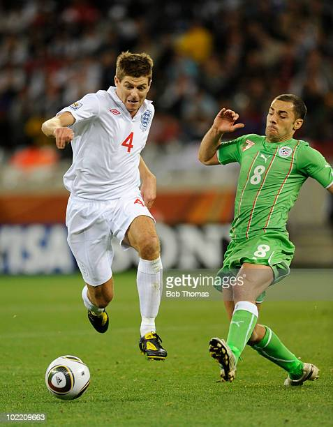 Steven Gerrard of England challenged by Medhi Lacen of Algeria during the 2010 FIFA World Cup South Africa Group C match between England and Algeria...