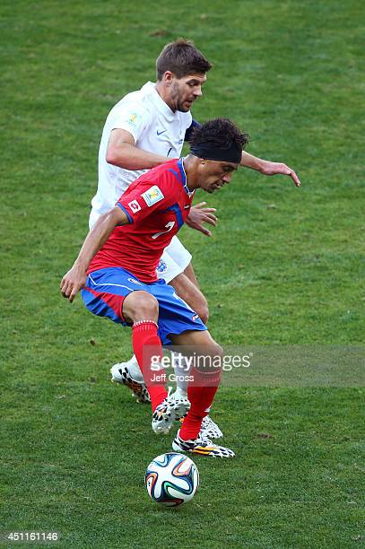 Steven Gerrard of England challenges Christian Bolanos of Costa Rica during the 2014 FIFA World Cup Brazil Group D match between Costa Rica and...