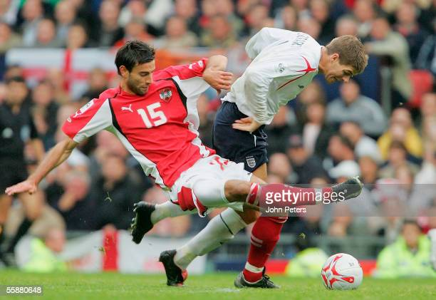 Steven Gerrard of England clashes with Yuksel Sariyar of Austria during the World Cup qualifying match between England and Austria at Old Trafford on...