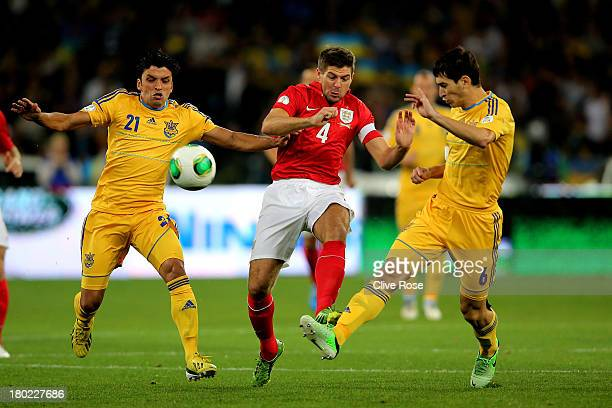 Steven Gerrard of England competes for the ball with Edmar and Taras Stepanenko of Ukraine during the FIFA 2014 World Cup Qualifying Group H match...