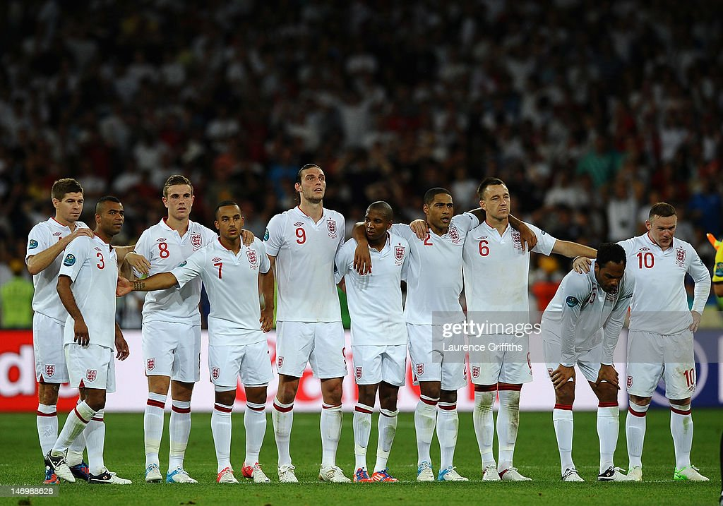 Steven Gerrard of England consoles Ashley Cole after missing his penalty during the UEFA EURO 2012 quarter final match between England and Italy at The Olympic Stadium on June 24, 2012 in Kiev, Ukraine.